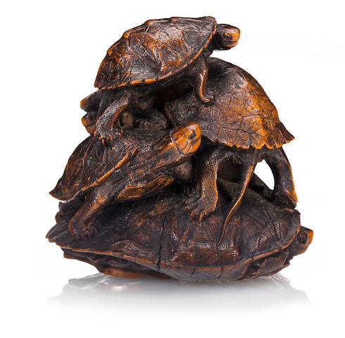 A wood netsuke of a group of turtles By Tadakazu, Edo period (19th century)