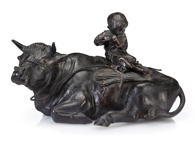 A bronze model of an oxherd playing flute on the  back of his ox