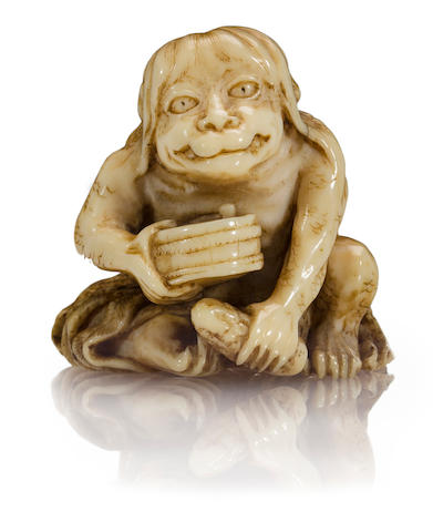 An ivory netsuke of a kappa By Ikkosai Toun, late Edo period (19th century)