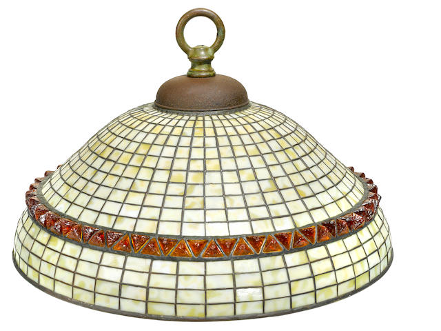 A Tiffany Studios Favrile glass and patinated bronze geometric and chunk glass chandelier