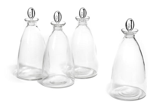 A set of four Lalique decanters from the Oviatt building