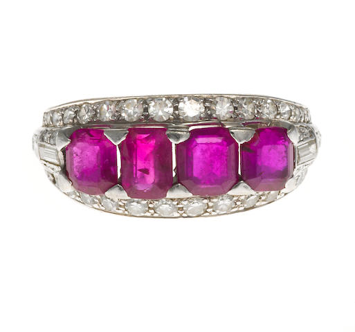 A pink sapphire and diamond four-stone ring