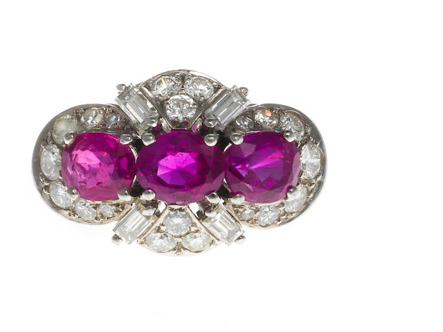 A three stone pink sapphire and diamond ring