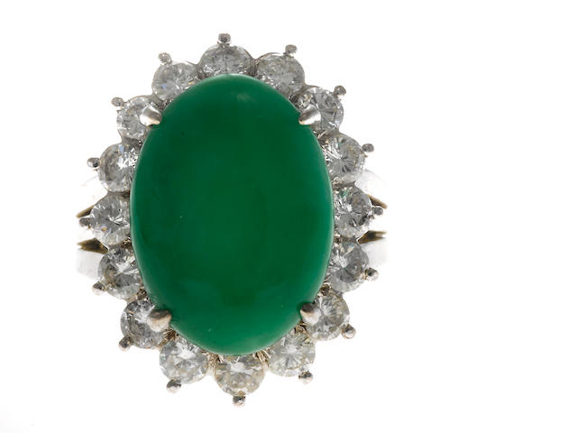 An oval jade, diamond and 18k gold ring; with cert