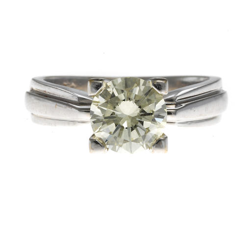 A diamond and 18k white gold solitaire ring