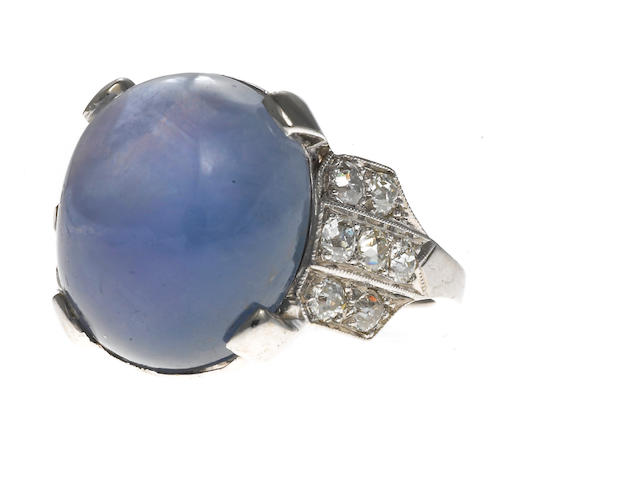An art deco star sapphire, diamond and platinum ring