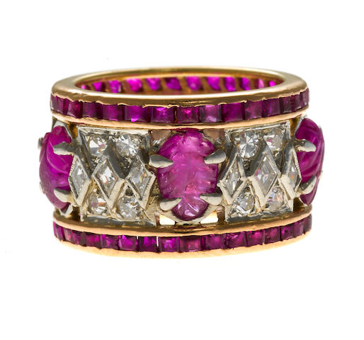 carved ruby and diamond band set in platinum and gold, accented by kite and round diamonds