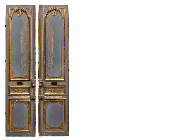 A pair of Neoclassical style paint decorated and parcel gilt paneled doors
