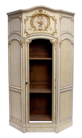 A Napoleon III paint decorated and parcel gilt corner cabinet
