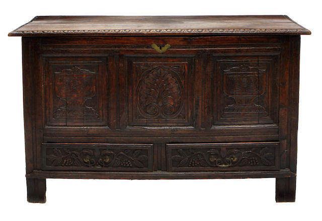 A Continental Baroque oak carved chest