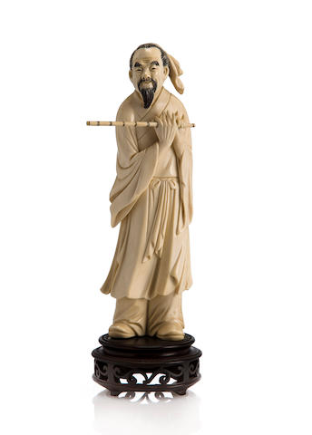 Chinese carved ivory okimono of figure with flute, c. 1900