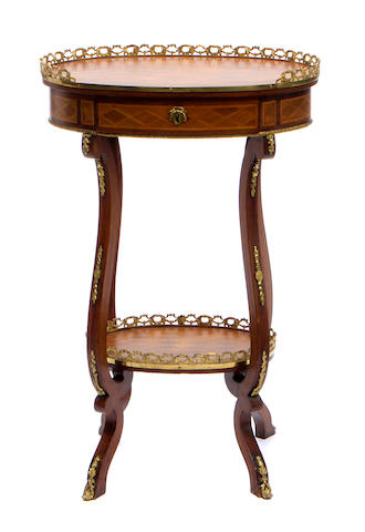 A Louis XV style gilt bronze mounted parquetry inlaid side table