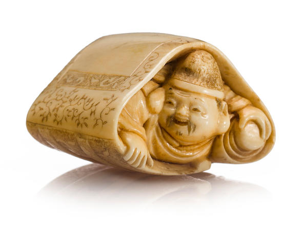 An ivory netsuke of Ebisu By Chokusai, Meiji period (late 19th century)