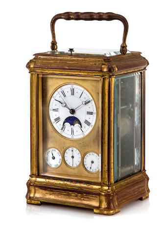 A rare gilt brass grande sonnerie quarter repeating center seconds carriage clock with calendar, moon phase and alarm Signed Breguet, No. 2443, last quarter 19th century