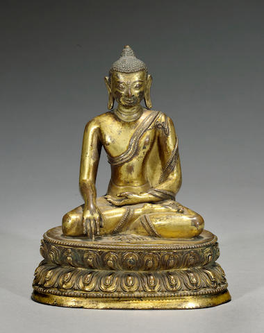 A gilt copper alloy figure of the Shakyamuni Buddha