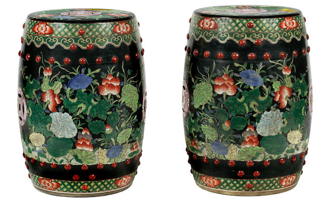 A pair of porcelain garden stools with famille noire enamels