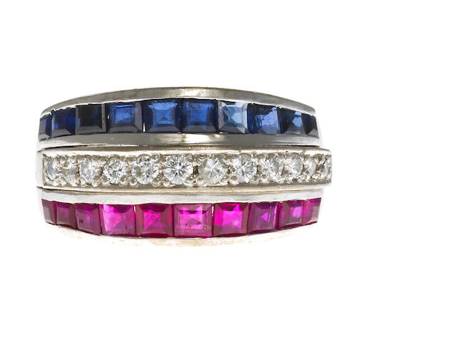 A sapphire, ruby and diamond three row band