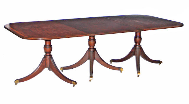 A Regency style mahogany triple pedastal dining table second half 20th century