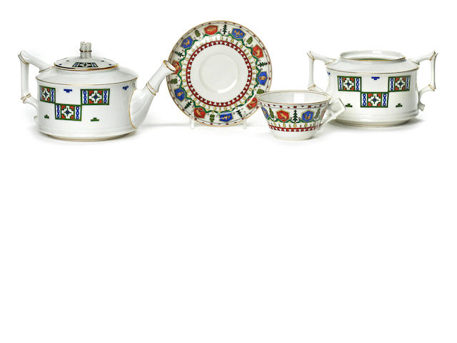 Collection of Russian porcelain by Kornilov, comprising one sugar bowl lacking lid, one tea pot and lid, one cup, and one saucer