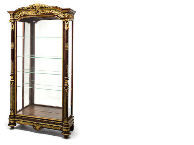 A Louis XVI style gilt bronze mounted ebonized wood vitrine by Guillaume Grohe, first half 19th century