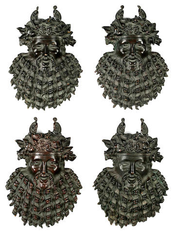 Four patinated bronze Bacchus mask mounts Italy or France, 19th century
