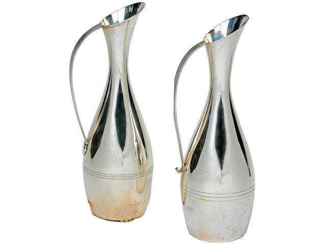A near pair of American sterling silver tall and attenuated pitchers by L. Huemer, mid-20th century