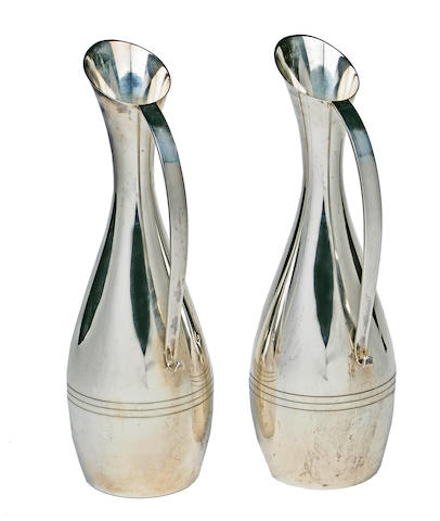 Another pair of sterling silver long and elongated oval pitchers in Brancusi style L. Huemer, mid-20th century