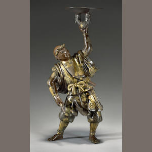 A Miyao-style patinated bronze figure. Meiji period