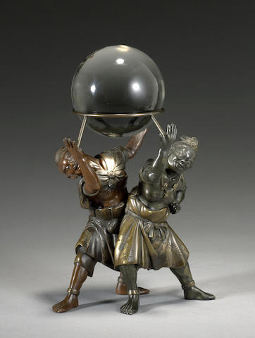 A bronze figural group and glass ball  Meiji period