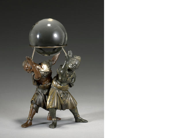 A bronze figural group and crystal ball<BR />Meiji period