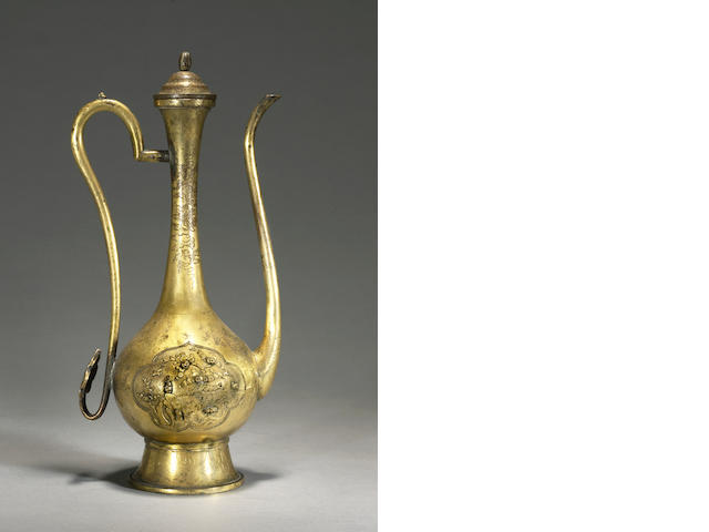 A parcel gilt bronze covered ewer 17th/18th century