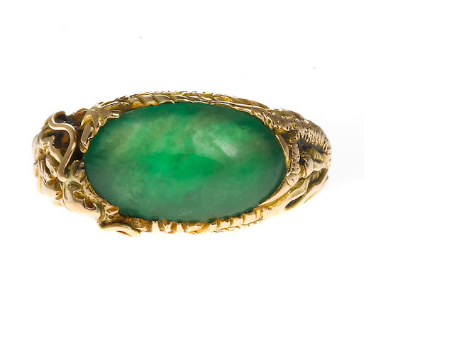 A jade and gold ring **SEND TO MASON KAY FOR CERT- RE EVALUATE ESTIMATE AND RESERVE DEPENDING ON RESULTS**