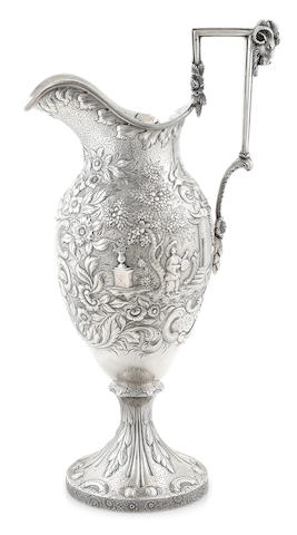 An American coin silver floral repousee and Chinoiserie scene decorated footed pitcher by Samuel Kirk, Baltimore, MD, circa 1840