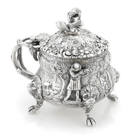 A Regency Britannia silver floral repousse and applied figural decorated mustard pot by Edward Farrell, London, 1818