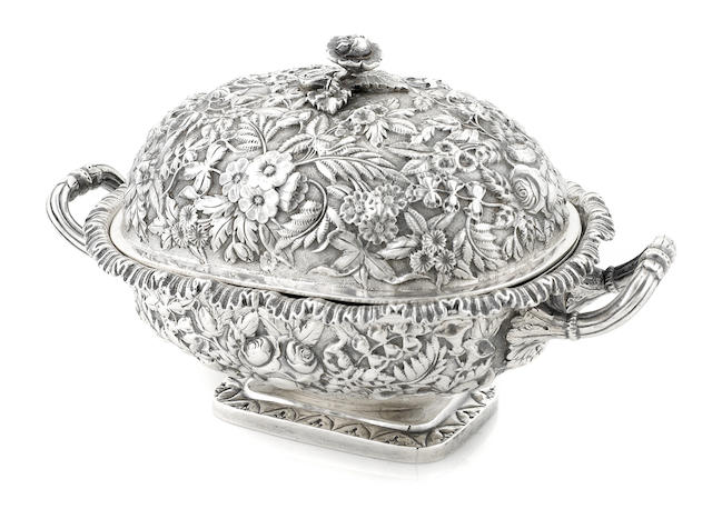 An American coin silver floral repousse decorated covered footed butter dish probably by Samuel Kirk, Baltimore, circa 1840