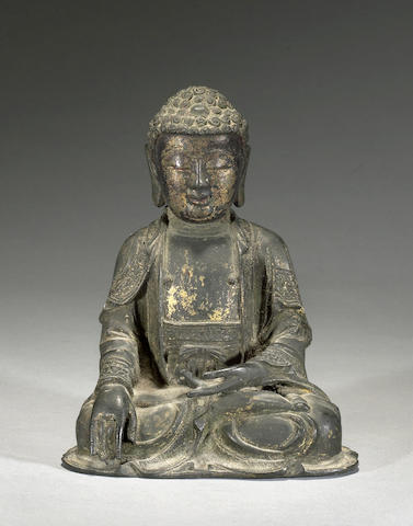 A cast bronze figure of Buddha Ming period