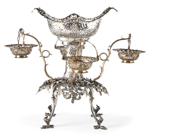 A George III silver epergne with four arms and pendant baskets by Thomas Pitts I, London, 1765