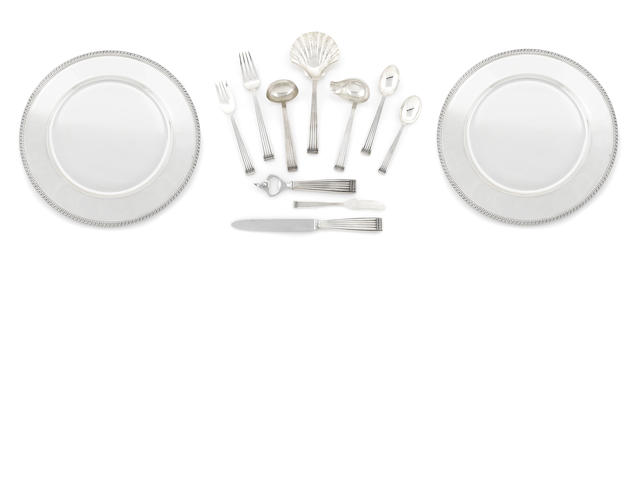 An Italian  sterling silver  flatware service for twelve with a pair of matching cased chargers Buccellati, Milan and Rome,  20th century