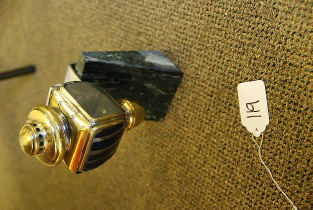 A single ornamental side lamp,