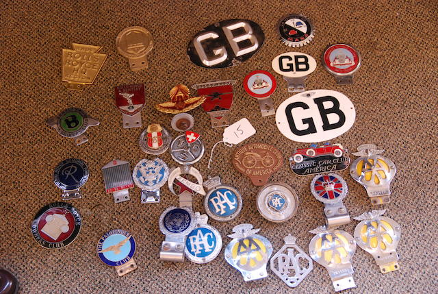 A large assortment of badges,