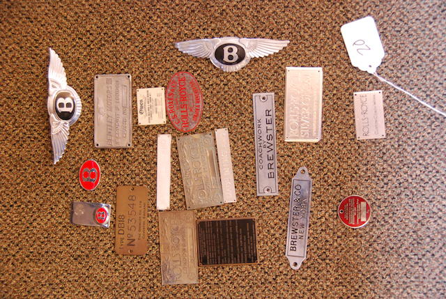 An assortment of Rolls-Royce and Bentley badges,