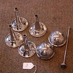 A set of four Lucas trumpet horn bells and caps,