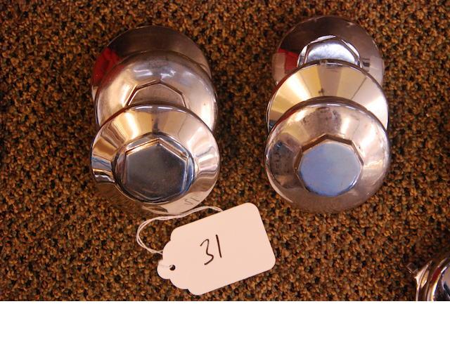 An assortment of Rolls-Royce parking radiator caps,