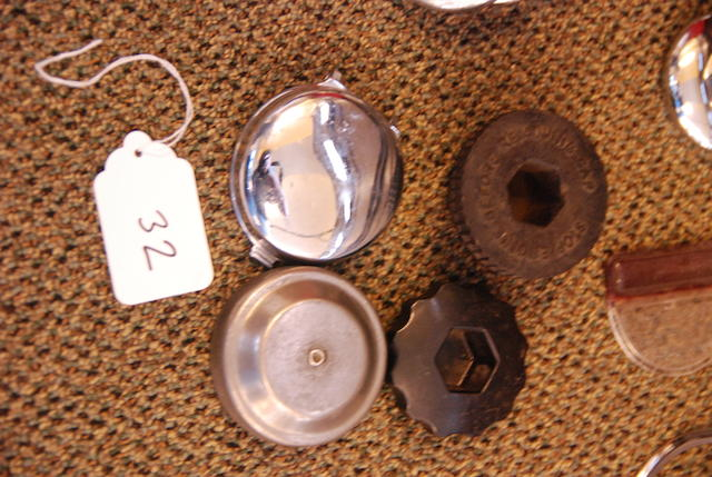 An assortment of Rolls-Royce radiator and gas caps,