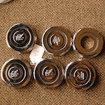 A set of six very well restored Rolls-Royce Phantom III hub locks,