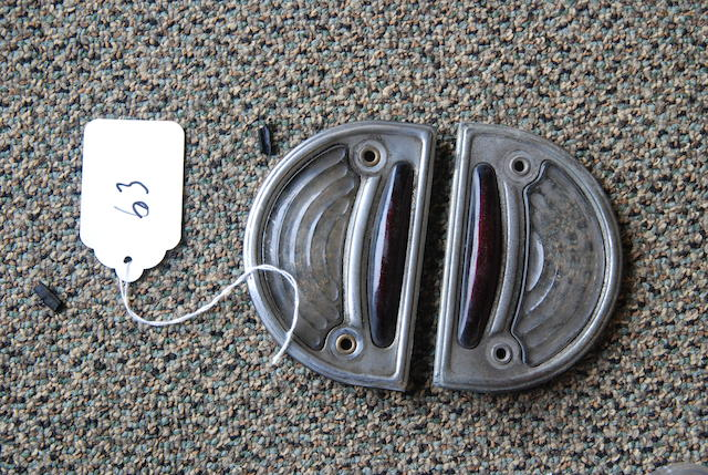 A set of license plate side lenses with metal bezels,