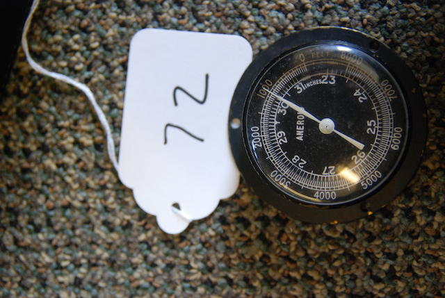 A small Aneroid gauge,