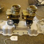 A reproduction Lincoln flathead V8 manifold,