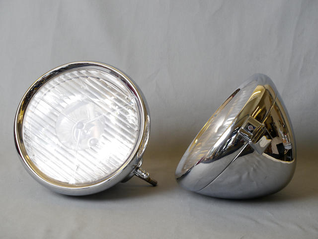 A set of restored Lucas P100R headlights,