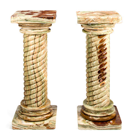 A pair of Baroque style torsade cut onyx columnar pedestals 20th century